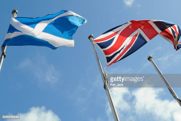 The Scottish saltire and union flag fly outside the Scottish Parliament as MSPs debate First Minister Nicola Sturgeon's call for the power to hold a...