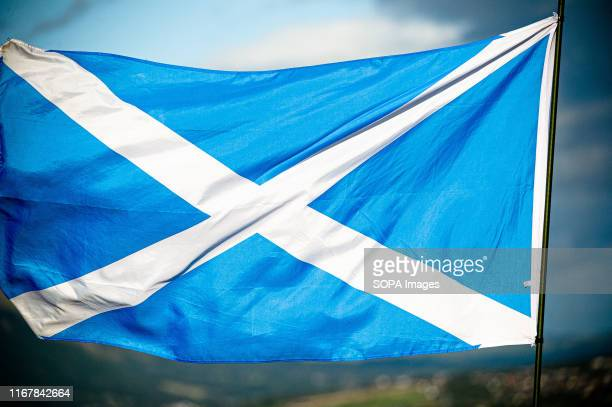 The Scottish saltire flies during the march. Scottish Indy group, Scotland Rise Now Become a Free Nation hosted a small unofficial march through...