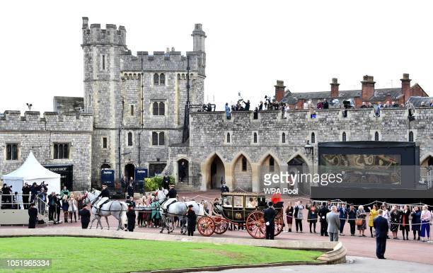 The Scottish State Coach with Princess Eugenie and Jack Brooksbank leaves St George's Chapel in Windsor Castle for a short Carriage Procession around...