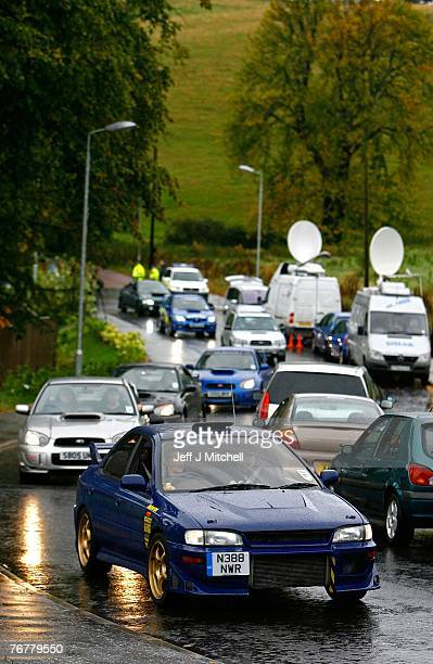 The Scottish Subaru Imprezza owners club drive past the home of Colin McCrae in Lanark where a twin squirrel helicopter has crashed yesterday...