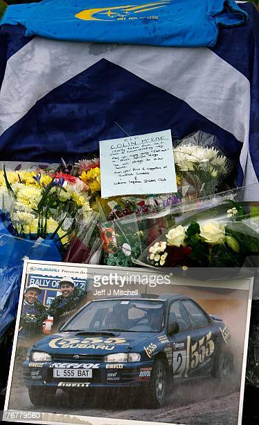 The Scottish Subaru Imprezza owners club leave flowers near the home of Colin McCrae in Lanark where a twin squirrel helicopter crashed yesterday...