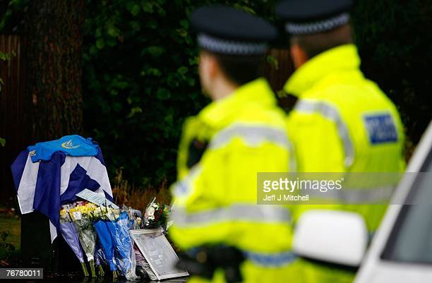 The Scottish Subaru Imprezza owners club leave flowers near the home of Colin McCrae in Lanark where a twin squirrel helicopter has crashed yesterday...