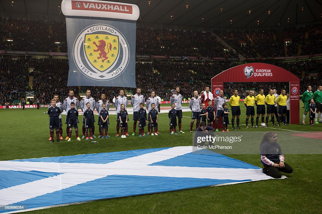 The Scottish team singing their national anthem before the