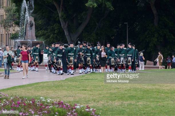 The Scott's college pipe band arrive across Hyde Park the funeral service for AC/DC cofounder Malcolm Young at St Mary's Cathedral on November 28...