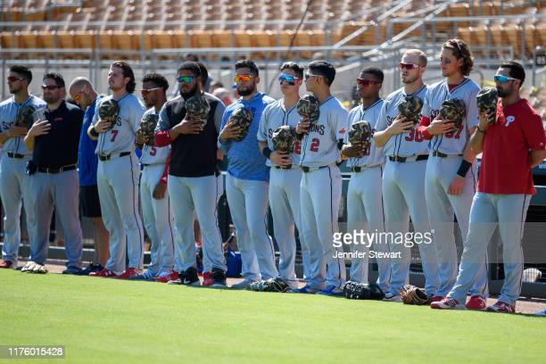 The Scottsdale Scorpions stand for the national anthem before the game against the Glendale Desert Dogs at Camelback Ranch on Sunday October 6 2019...