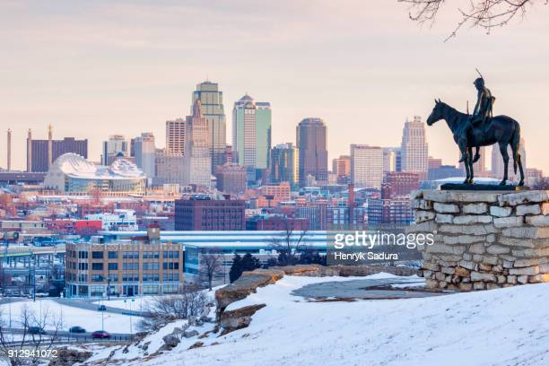 The Scout statue and Kansas City panorama at sunrise