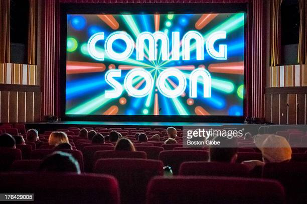 The screen at Coolidge Corner Theatre reads coming soon before showing trailers at the start of the 730 showing of Frances Ha