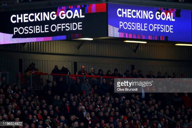 The screen inside the stadium shows that a VAR check is taking place after Pedro Neto of Wolverhampton Wanderers scores a goal, which is later...