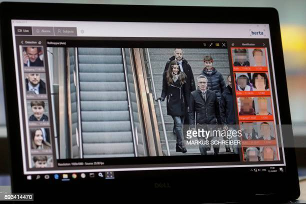The screen of a computer with an automatic facial recognition system shows German Interior Minister Thomas de Maiziere walking down stairs as he...