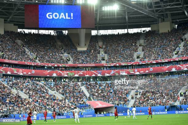 TOPSHOT The screen reads 'goal' after Portugal's midfielder Bernardo Silva scored a goal during the 2017 Confederations Cup group A football match...