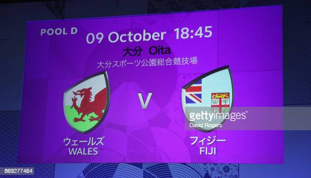 The screen shows the match between Wales and Fiji during the Rugby World Cup 2019 match schedule announcement at Grand Prince Hotel Shin Takanawa on...