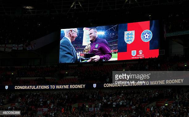 The screen shows Wayne Rooney of England being presented with the golden boot by Sir Bobby Charlton after becoming England's highest goalscorer...
