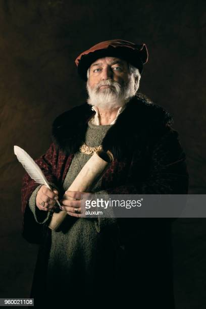 the scribe - quill pen stock photos and pictures