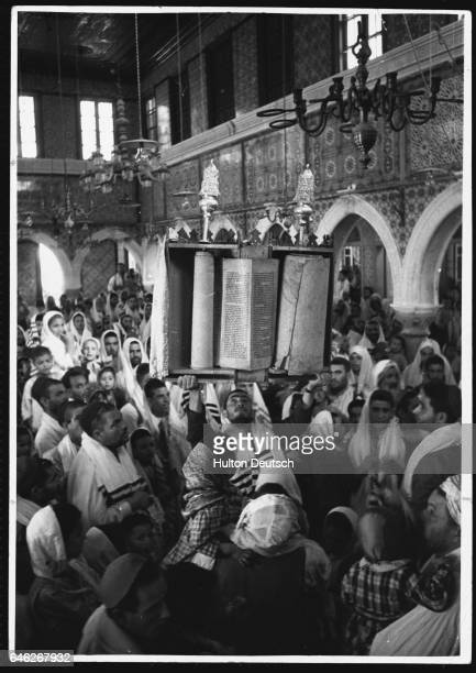 The scrolls of law are displayed in silver cases during the Jewish Simchat Torah feast in Djerba an island off Tunisia