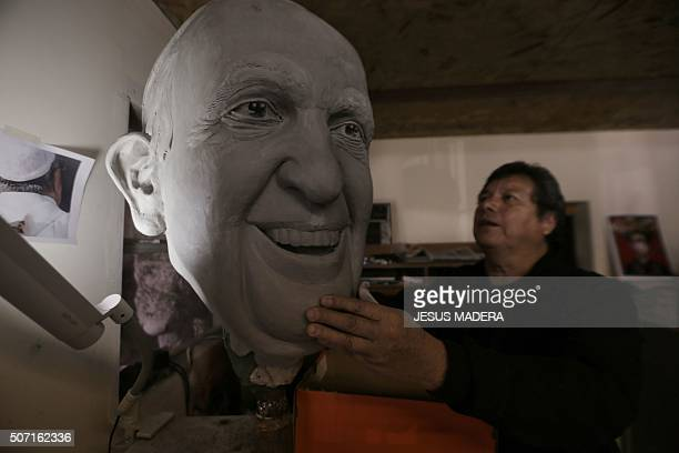 The sculptor Pedro Francisco Rodriguez works on a sculpture of Pope Francis in Ciudad Juarez Chihuahua state Mexico on January 27 2016 Pope Francis...