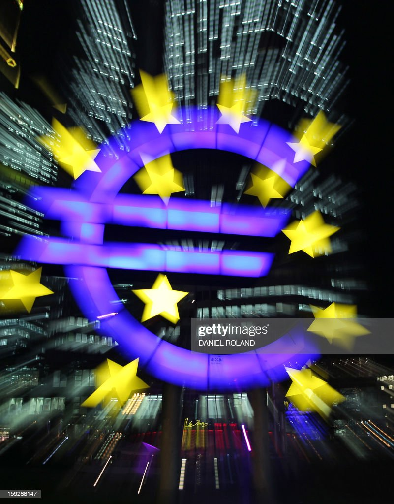 The sculpture by German artist Ottmar Hoerl's depicting the Euro is seen in front of the European Central Bank, ECB in Frankfurt am Main, western Germany, on January 10, 2013. The euro shot up, gaining 1.5 percent against the dollar, after European Central Bank chief Mario Draghi made upbeat remarks about the eurozone's economic outlook. / AFP PHOTO / Daniel ROLAND