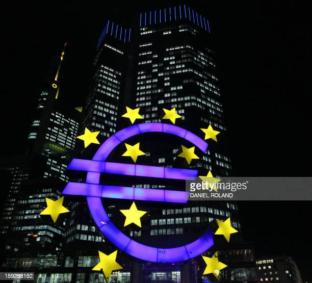 The illuminated EURO sign is seen in front of the European Central Bank ECB in Frankfurt am Main western Germany on January 10 2013 The euro shot up...