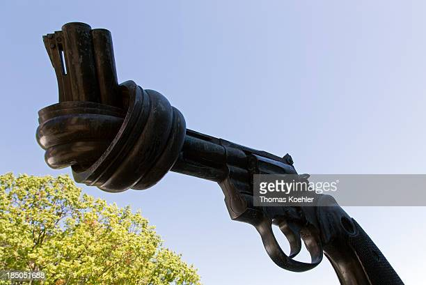 The sculpture by Swedish artist Carl Fredrik Reuterswaerd showing a revolver tied in a knot called Non Violence on display outside United Nations...