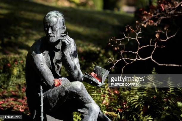 The sculpture depicting Irish author James Joyce is seen behind his grave in Fluntern cemetery in Zurich on October 17 2019 According to the Guardian...