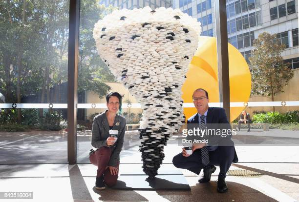 The sculpture 'Disposable Truths' by Marina DeBris is seen behind the artist and Bruce Precious the GPT Group National Manger for Sustainability and...