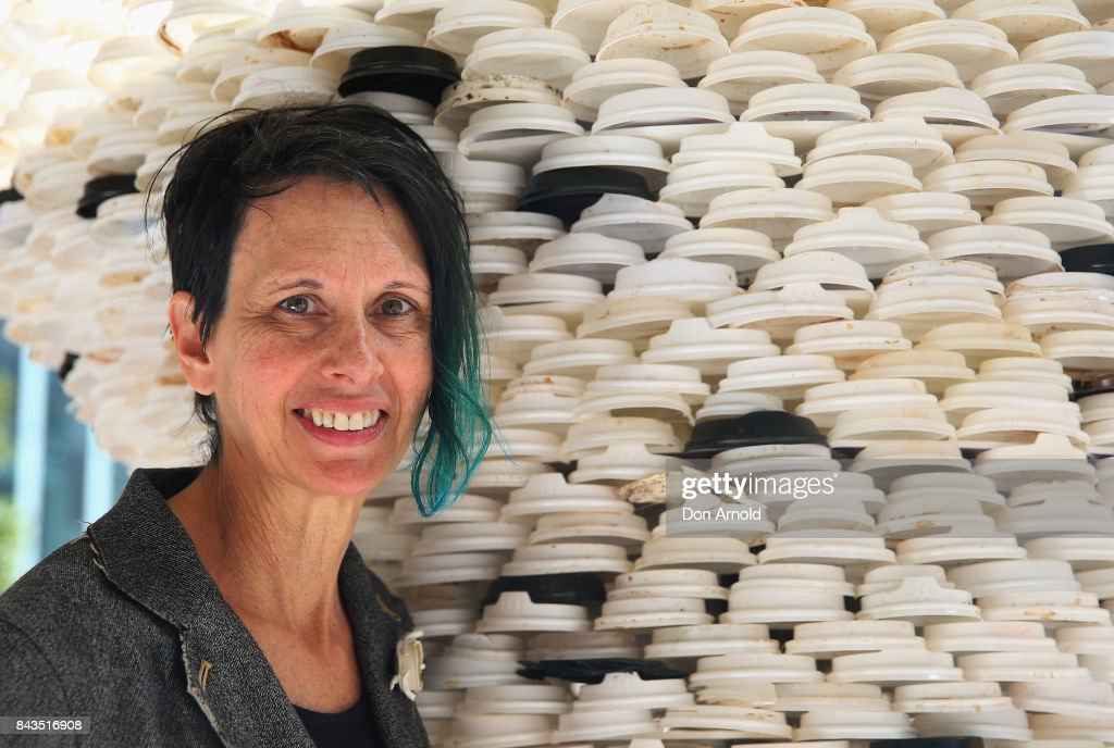 The sculpture 'Disposable Truths' by Marina DeBris is seen behind the artist on September 7, 2017 in Sydney, Australia. The Sydney artist created the sculpture from 1000 coffee cups collected at the MLC Centre over one month, to highlight how waste affects the environment.