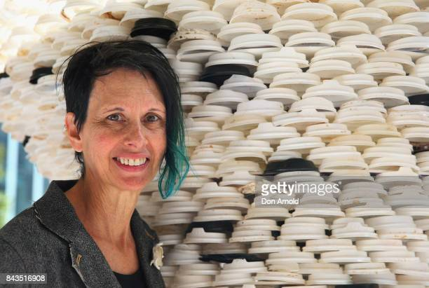The sculpture 'Disposable Truths' by Marina DeBris is seen behind the artist on September 7 2017 in Sydney Australia The Sydney artist created the...