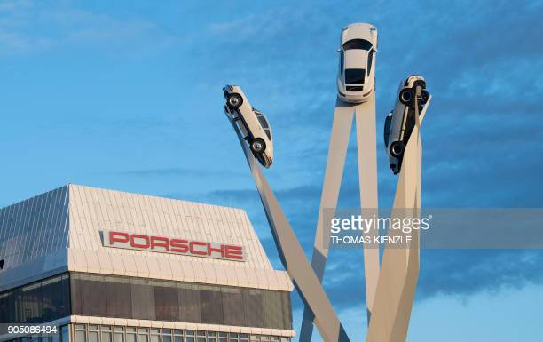 The sculpture 'Inspiration 911' made by the British artist Gerry Judah showing three Porsche 911 sportscars is seen in front of the headquarters of...