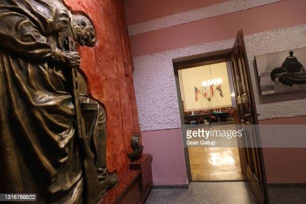 The sculpture of a World War II Soviet soldier stands next to the room where German military leaders, in a meeting with the Allied powers of the...