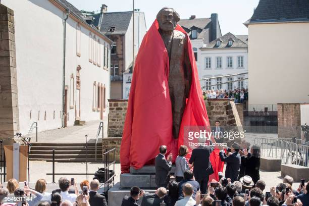 The sculpture of German philosopher and revolutionary Karl Marx is uncovered during its inauguration at the 200th anniversary of the birth of Karl...