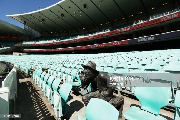 """The sculpture of """"Yabba"""" is seen with empty stands after Cricket Australia announced no public will be admitted to venues for the three match series..."""