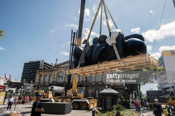 The sculpture 'The couple' by Costa Rican sculptor based in Italy Jorge Jimenez Deredia is lifted by a crane during its installation outside the...