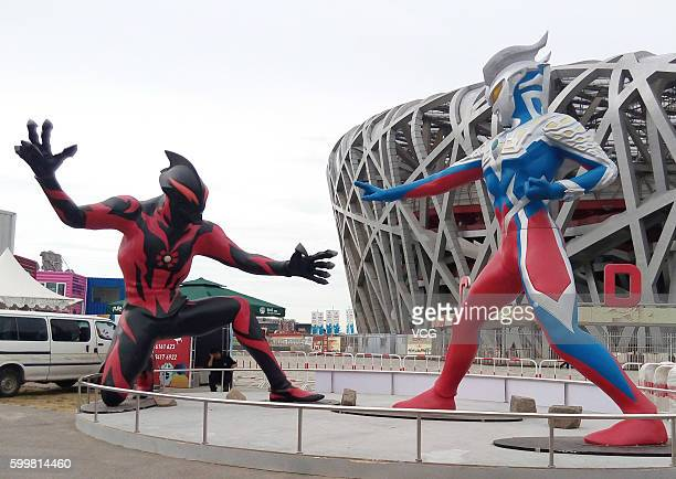 The sculptures of a 5metertall superhero 'Ultraman' and a monster Belial beside the National Stadium on September 6 2016 in Beijing China The...