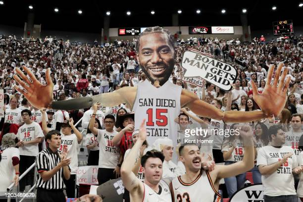 The SDSU student section displays a giant Kawhi Leonard cutout prior to the game between the San Diego State Aztecs and the Utah State Aggies at...
