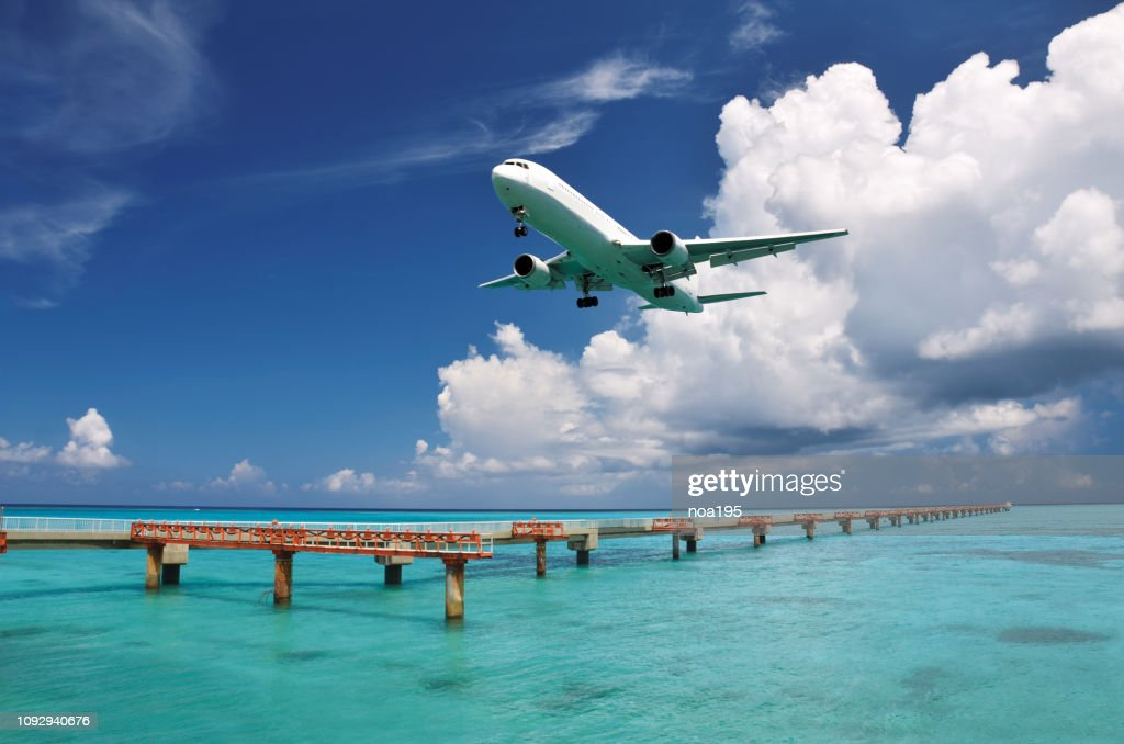 The sea and Plane -Shimojishima Airport(Shimoji Airport)Runway 17END : Stock Photo