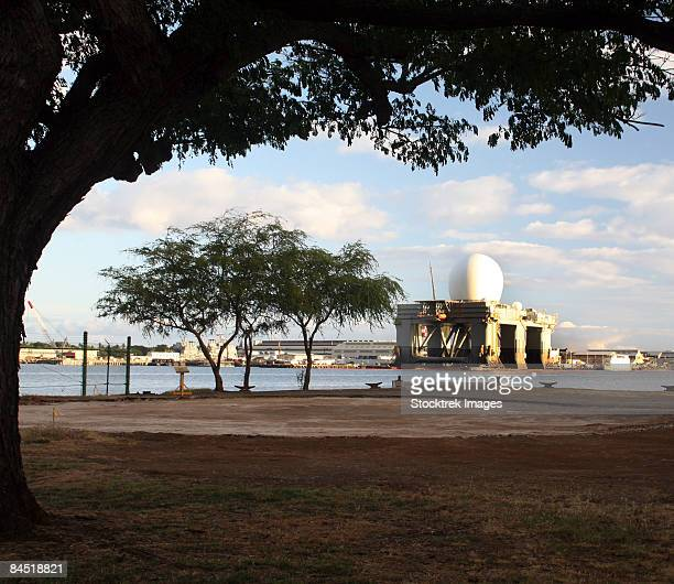 the sea based x-band radar is an integral part of the ballistic missile defense system and is temporarily located at the pearl harbor naval base shipyard.  - pearl harbor naval shipyard stock photos and pictures