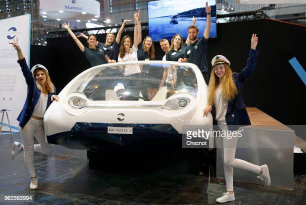 The Sea Bubbles team poses with a Sea Bubbles water car ecosystem during the Viva Technology show at Parc des Expositions Porte de Versailles on May...