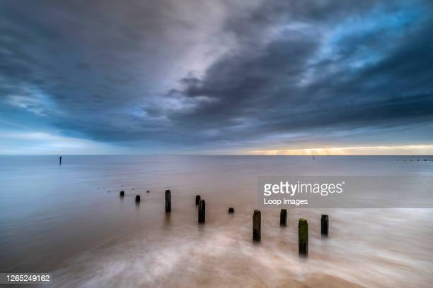 The sea defences at Overstrand on the North Norfolk coast at sunrise.