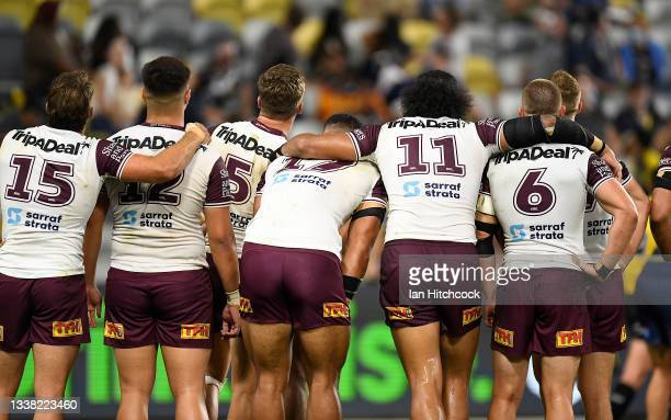 The Sea Eagles look up at a replay on the big screen after a try during the round 25 NRL match between the North Queensland Cowboys and the Manly Sea...