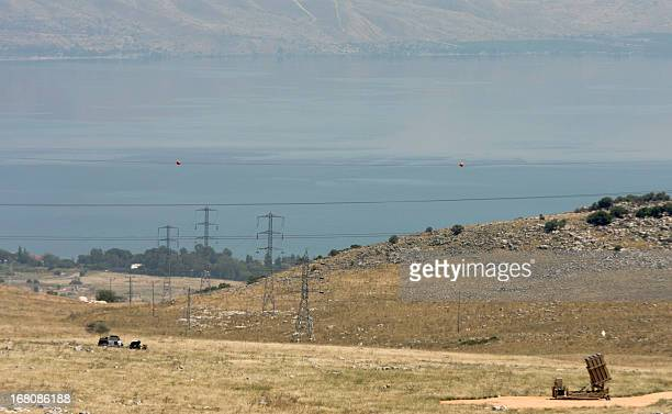 The Sea of Galilee is seen in the background as an Iron Dome a shortrange missile defence system is positioned on a hill in northern Israel on May 5...