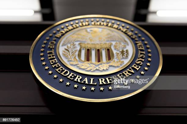 The seal of the Board of Governors of the Federal Reserve System hangs on a table before a news conference with Federal Reserve Chair Janet Yellen...