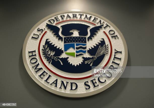 The seal of the Department of Homeland Security is seen at US Immigration and Customs Enforcement in Washington DC February 25 2015 AFP PHOTO / SAUL...