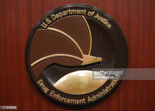 The seal of the Drug Enforcement Administration is seen on a lectern before the start of a press conference at DEA Headquarters on June 26 2013 in...
