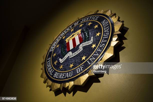 The seal of the Federal Bureau of Investigation hangs on a wall before a news conference at the FBI headquarters in Washington DC US on Thursday June...