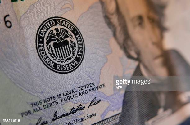 The seal of the Federal Reserve is seen on a US banknote on June 1 2016 in Washington DC The Fed has signaled a rate hike could be possible at its...