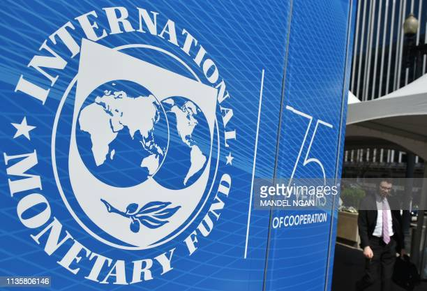 The seal of the International Monetary Fund is seen outside of the headquarters building in Washington, DC on April 8, 2019.