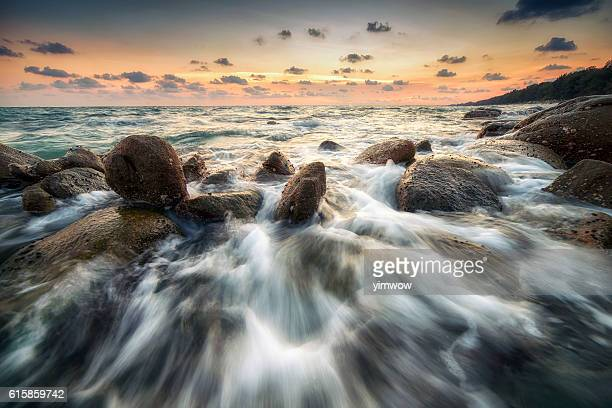 The seascape of waves and rocks