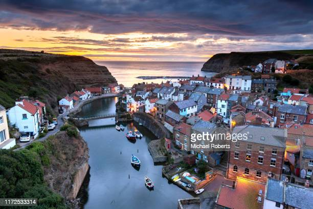 the seaside fishing village of staithes in yorkshire at sunrise - tranquil scene stock pictures, royalty-free photos & images