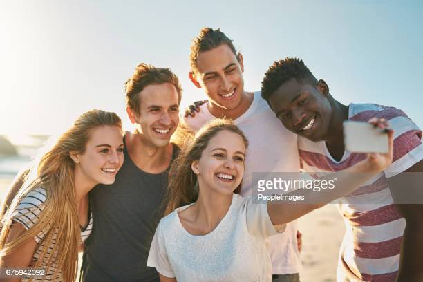 the season for selfies - clique stock photos and pictures