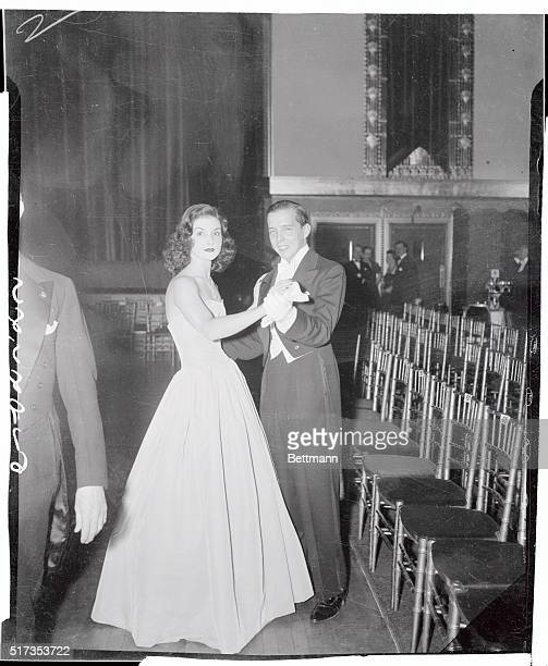 The season's number one debutante Brenda Frazier daughter of Mrs Frederick N Watriss is shown dancing with one of her four escorts at the Louis XIV...
