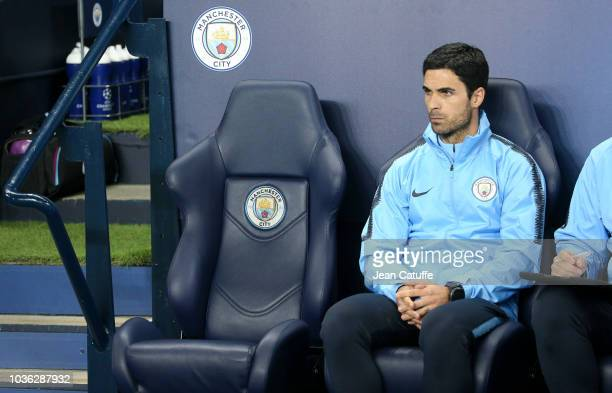The seat of Pep Guardiola is empty assistant coach of Manchester City Mikel Arteta during the Group F match of the UEFA Champions League between...